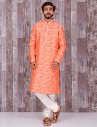 Printed orange cotton kurta suit