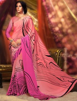 Printed peach and pink crepe saree