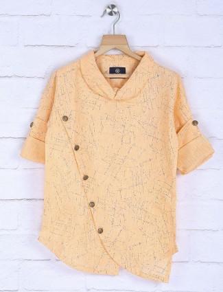 Printed peach hued cotton kurta suit