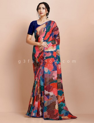 Printed pink party wear georgette sari