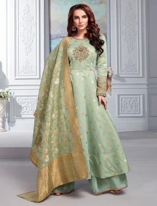 Pakistani palazzo suit in green cotton silk
