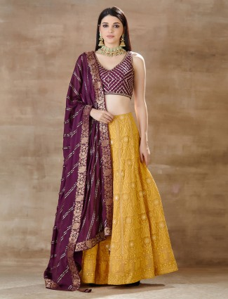 Purple and yellow wedding lehenga in georgette
