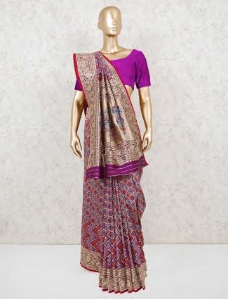 Purple bandhej wedding saree with beads work
