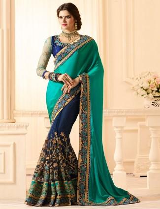 Rama green and navy half and half saree