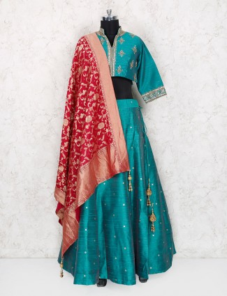 Rama green raw silk fabric wedding wear lehenga choli