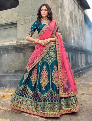 Rama green silk lehenga with net odhani for wedding function