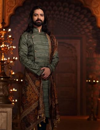 Raw silk kurta suit in green color