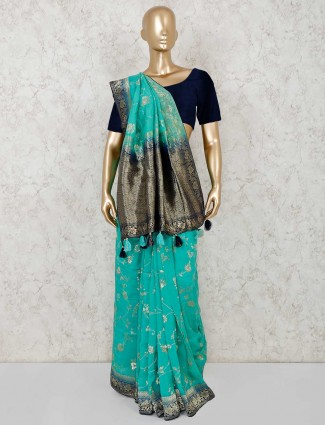 Reception wear teal green semi silk saree