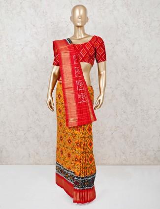 Red and orange ikat thread weaving Hyderabadi patola silk saree