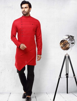 Red color pleated pattern solid kurta suit