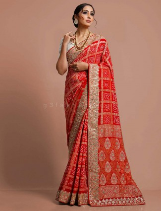 Red designer bandhej saree in bridal wear