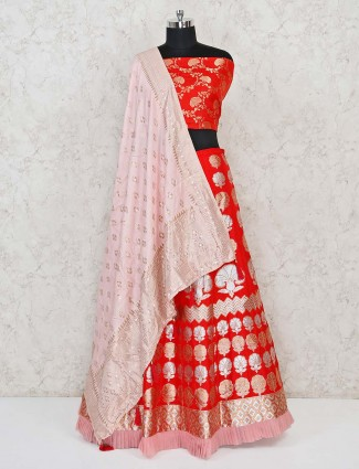 Red semi stitched lehenga choli in banarasi silk with floral zari weaved