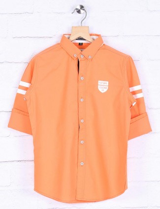 Ruff denim hued solid orange shirt