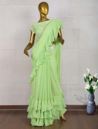 Ruffle style green georgette saree