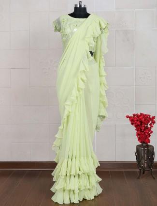 Ruffle style green hue georgette saree
