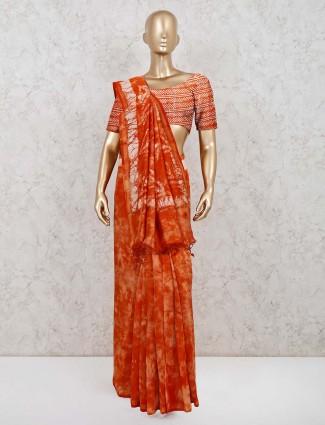 Rust orange cotton printed saree for festive