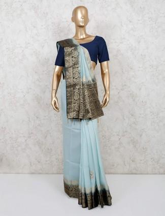Sea green colored dola silk saree