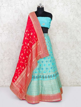 Sea green colored semi stitched banarasi silk lehenga