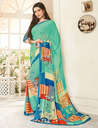 Sea green floral printed georgette saree