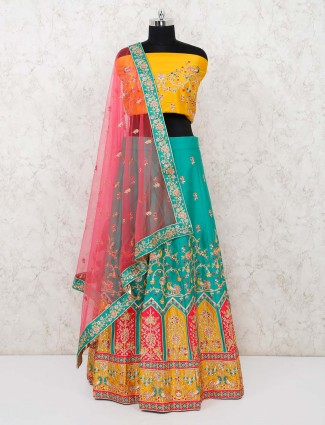 Sea green semi stitched art silk lehenga with yellow blouse and red dupatta