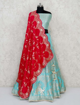 Semi stitched aqua blue banarasi lehenga with red dupatta