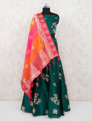 Semi stitched bottle green solid silk lehenga with banarasi dupatta