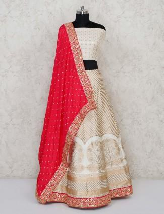 Semi stitched cream banarasi lehenga choli with red dupatta