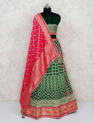 Semi stitched Green georgette bandhani lehenga with magenta dupatta