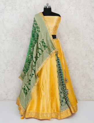 Semi stitched yelloow banarasi lehenga choli  with green bandhej dupatta