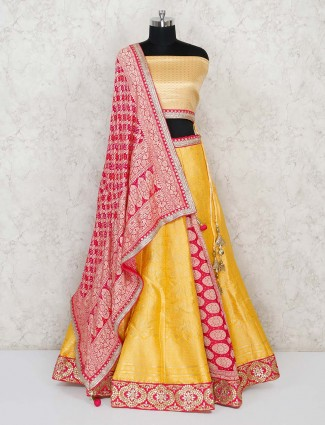 Semi stitcher yellow Banarasi lehenga choli in half and half pattern