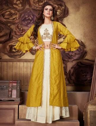 Silk cream gold jacket style lehenga suit