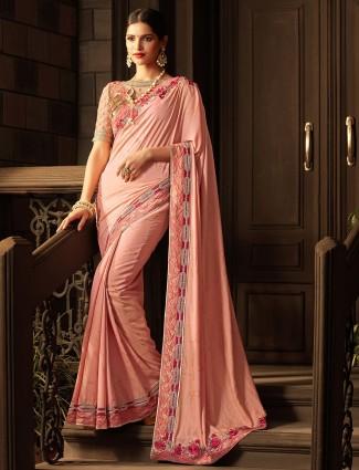 Silk designer saree in coral pink color