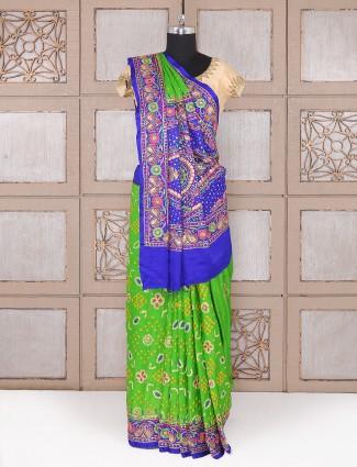 Silk fabric parrot green saree