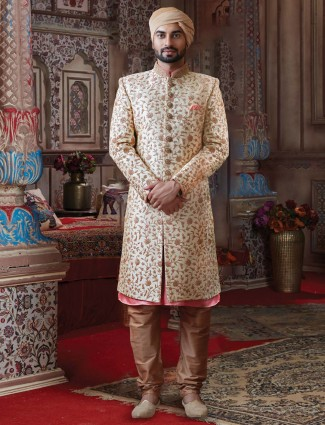 Silk sherwani in cream colour for groom