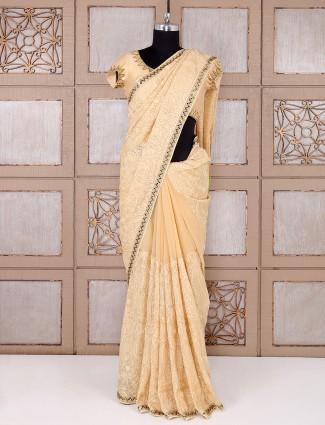 Simple party wear beige georgette saree