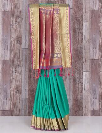 Sober green silk saree