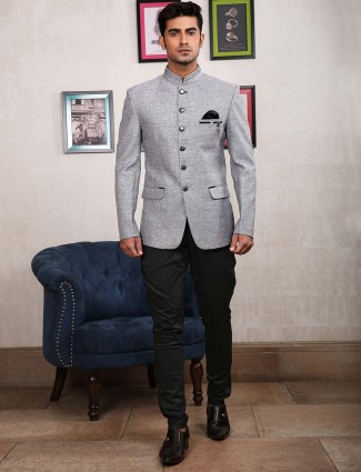 Solid grey colored party occasion jodhpuri suit