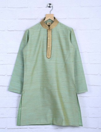 Solid light green colored kurta suit