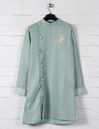Solid pista green kurta suit in cotton