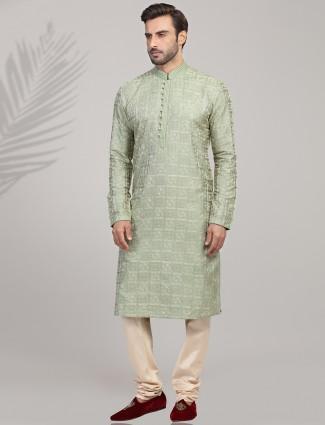 Stand collar pista green cotton silk kurta suit