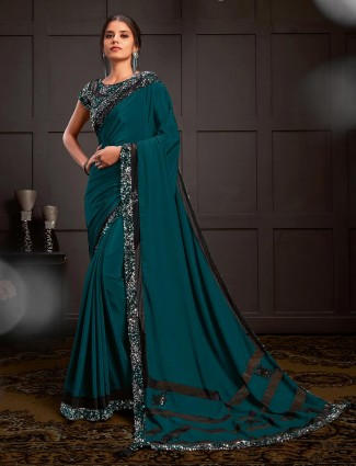 Teal blue latest party saree design in silk georgette