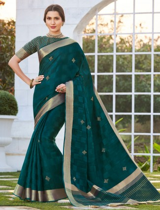 Teal green saree with the mukeish work