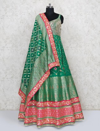 Traditional green anarkali suit for wedding in patola silk