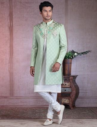 Traditionl double layer pista green silk sherwani with zari touch