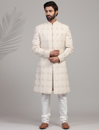Trendy cream hue sherwani in silk for groom