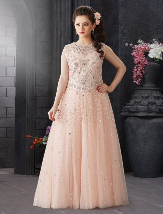 Wedding function peach hue designer gown