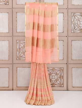 Wedding wear georgette fabric saree in peach color