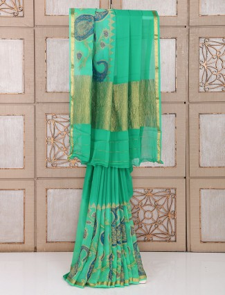 Wedding wear georgette saree in green color