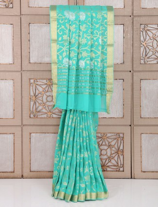Wedding wear georgette saree in sea green color