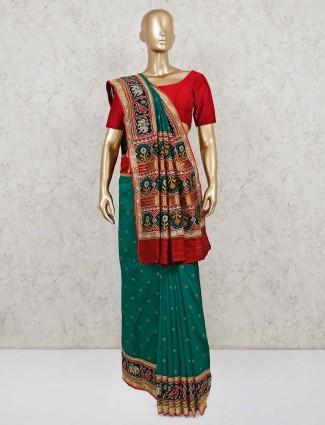 Wedding wear patola silk saree in green